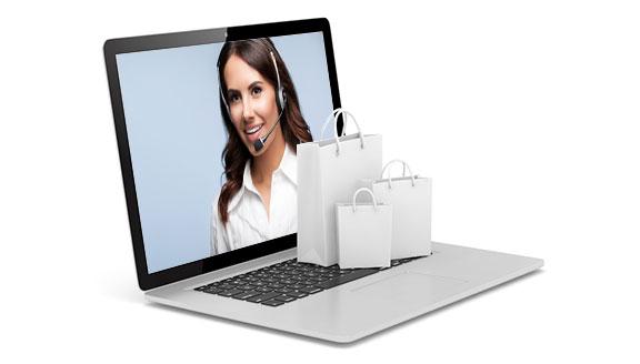 Laptop mit Shoppingtaschen